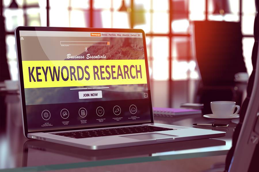 Laptop Screen with Keywords Research Concept.